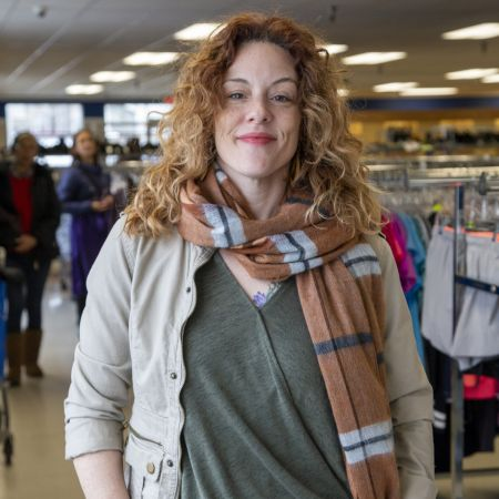 Woman posing in Goodwill store.