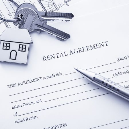 Image of rental agreement and keys.