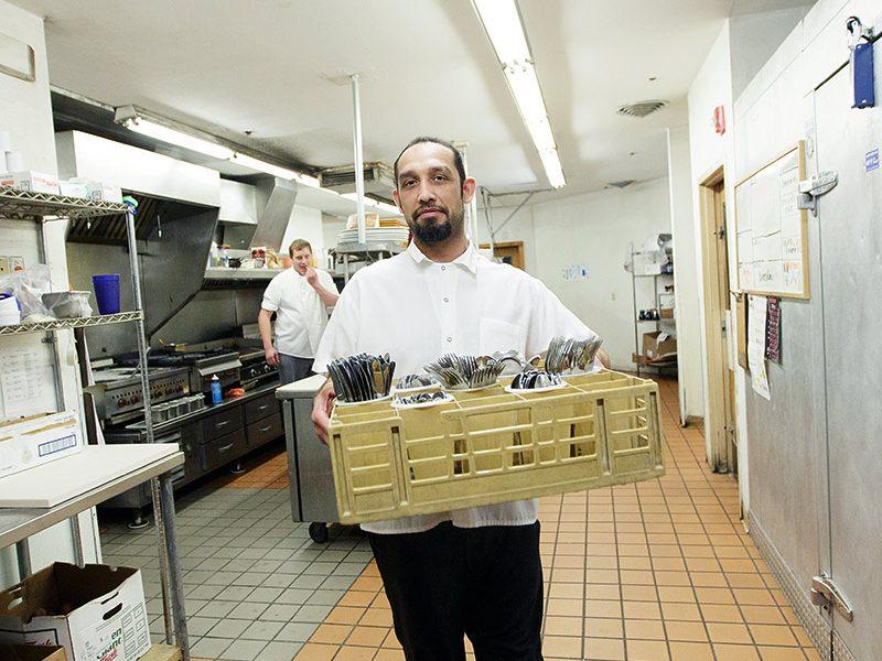 man with restaurant dish tray.
