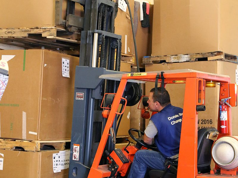 Goodwill employee operating forklift.